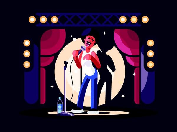 Standupkomikeren har scenen og en mikrofon til sin rådighed.
