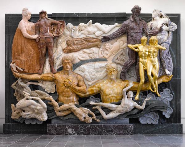 """Værket """"Det store relief"""" indeholder symbolske elementer. Det er lavet af J.F. Willumsen, og siger noget om Willumsens syn på tilværelsen og menneskelivet."""